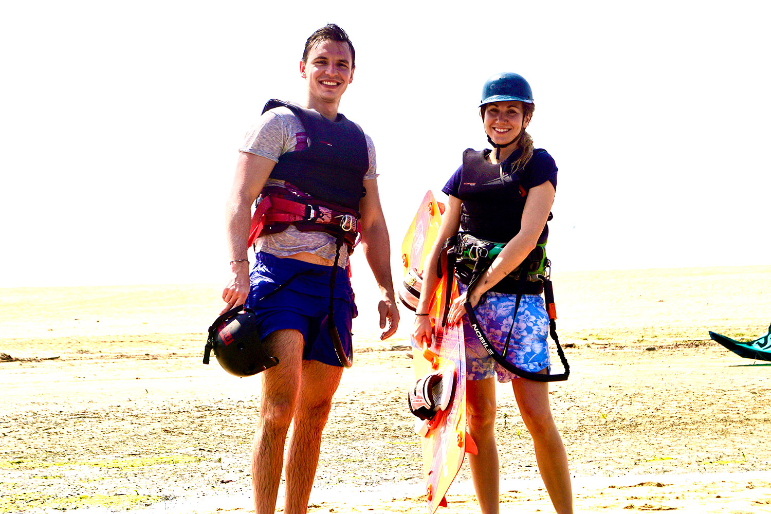 Couple Kite Surfing In Ocean - kalpitiya